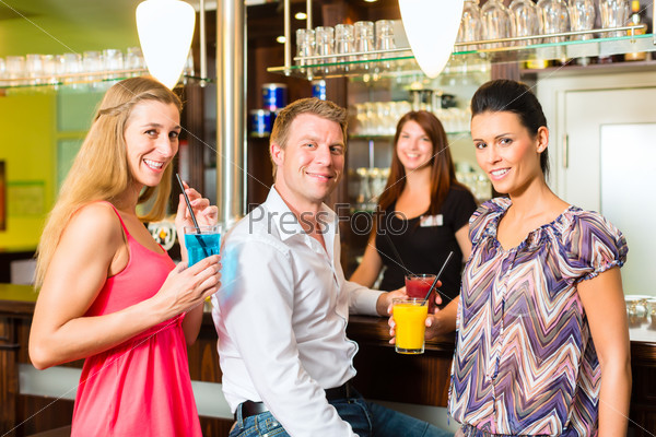Young people with cocktails in bar