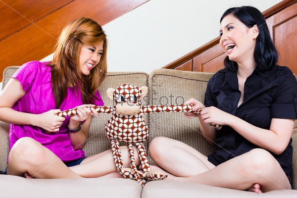 Two asian girls at home