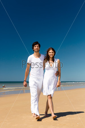 Couple enjoying freedom on the beach
