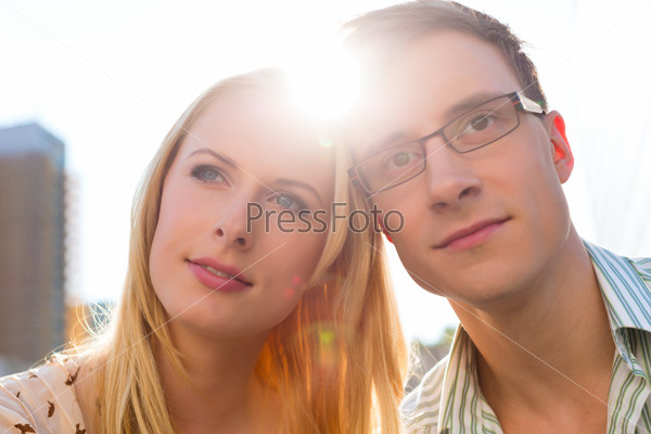 Couple in love looking dreamily into the sky