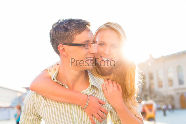 Happy couple - man carrying woman piggyback