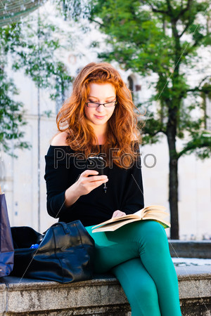 Young Woman calls with mobile phone in Park
