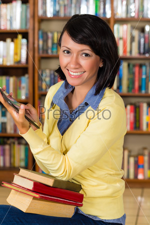 Girl at library reading a e-book