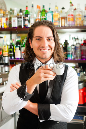 Barista in his cafe or coffeeshop