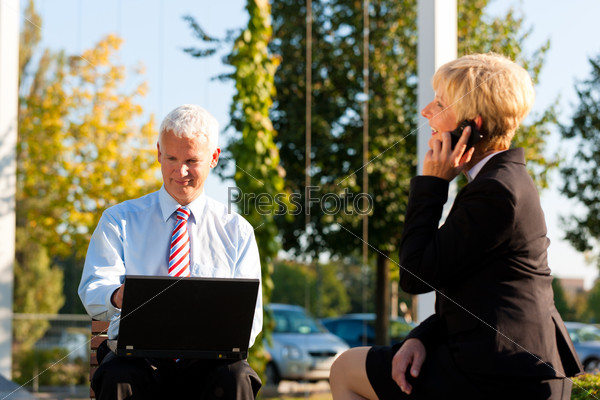 Business people working outdoors