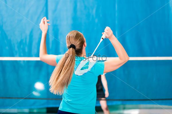 Badminton sport in gym, women playing