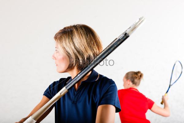 Squash racket sport in gym