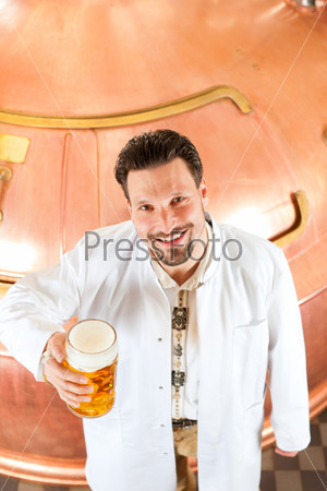brewer with beer glass in brewery