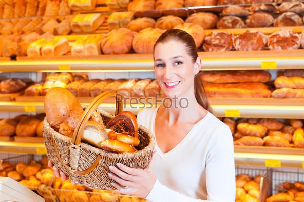 Female baker selling bread in her bakery