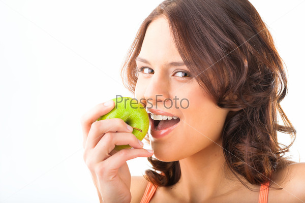 Young woman bites in a fresh and healthy apple