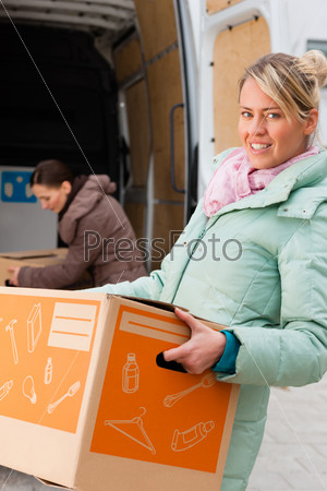 Female friends loading a moving truck