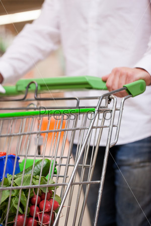 Male Shopper with Trolley at Supermarket