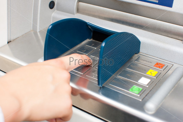 Woman at ATM or cash dispenser
