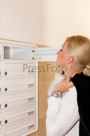 Woman looking after mail in letter box