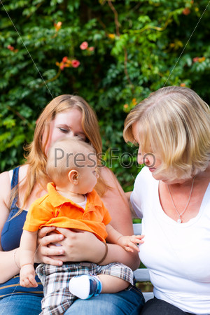 Family - Grandmother, mother and child in garden