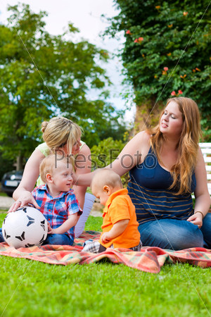 Mother and grandmother with children in a park