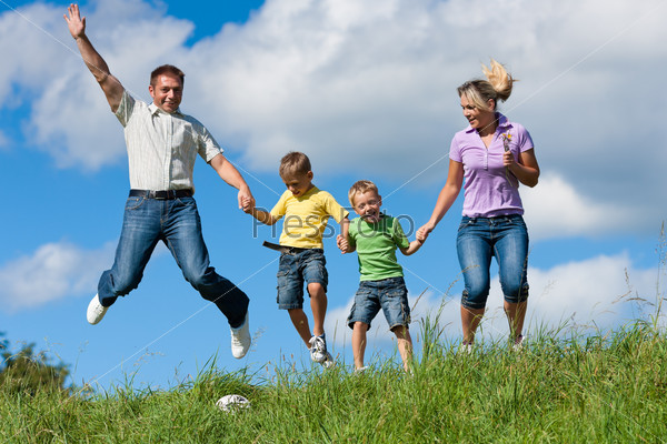Family outdoors jumping