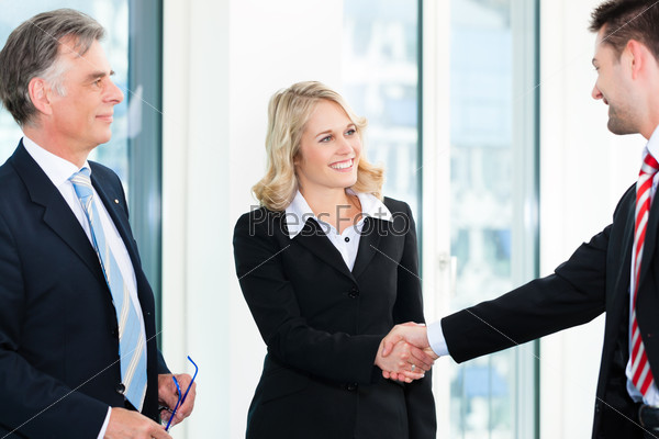 Business people doing Handshake