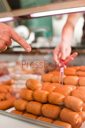 Customer Buying Sausages At Butchery