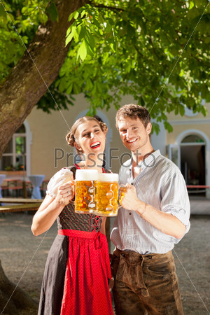Couple with beer stein and traditional clothes