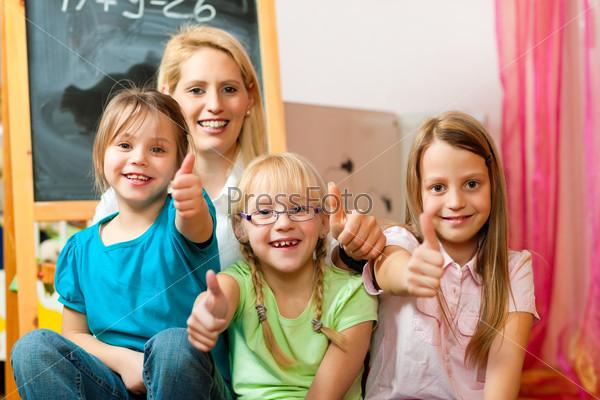 Mother with schoolchildren