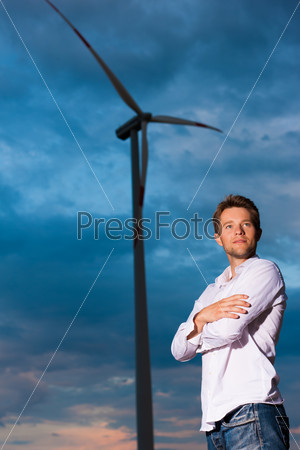 Man in front of windmill and sky