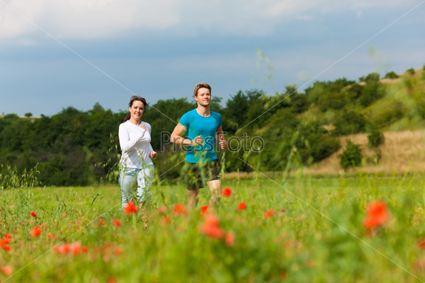 Young sportive couple is jogging outside