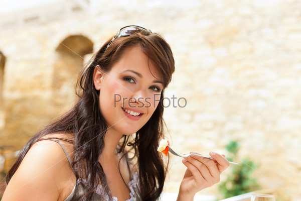 Woman eating food in the afternoon