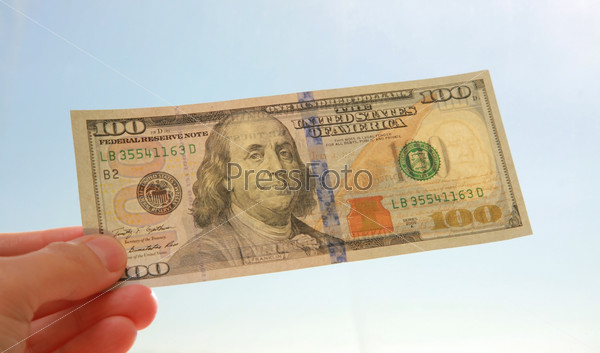 One hundred dollar banknote in sunlight