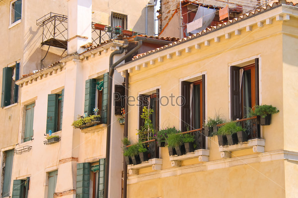 Picturesque Italian house with flowers on the balconie