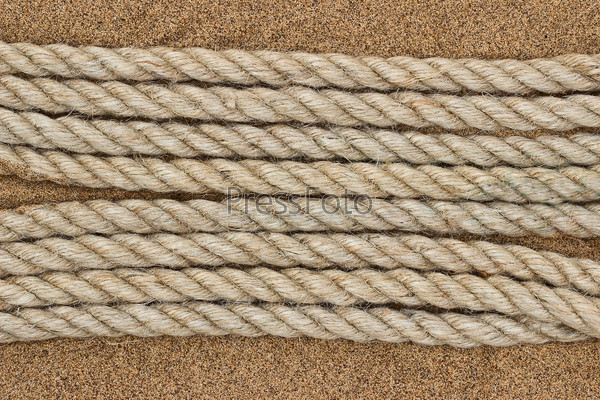 Jute rope on the sea sand