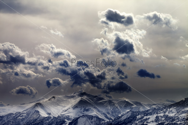 Evening mountains and cloudy sky