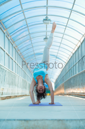 Woman doing yoga stretching bridge pose