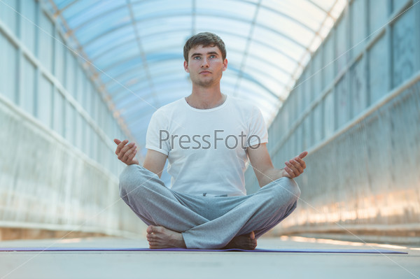 Man meditating lotus position