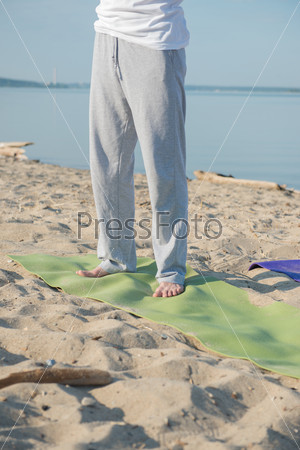 Man yoga mat beach