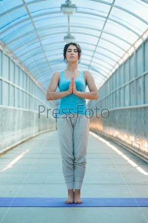Young woman prayer position