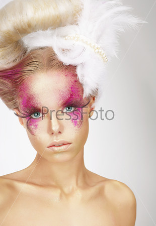 Showy Woman with Fuzzy Feathers and Fantastic Art Makeup