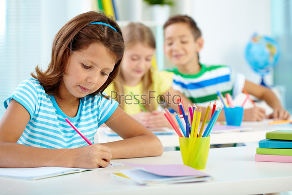 Schoolgirl at drawing lesson