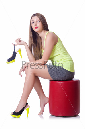 Young woman trying new shoes isolated on white