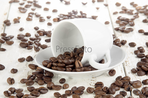 freshly roasted coffee beans and cup