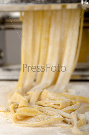 pasta dough is being processed