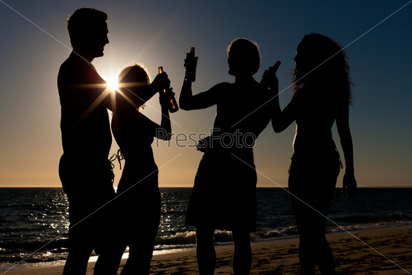 People having party at beach with drinks