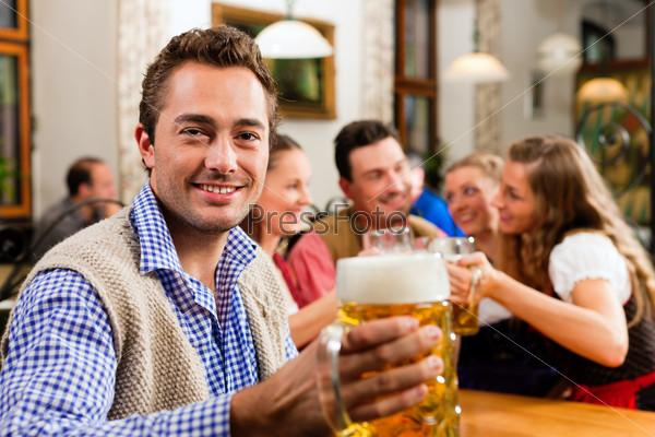 Man drinking beer in Bavarian pub