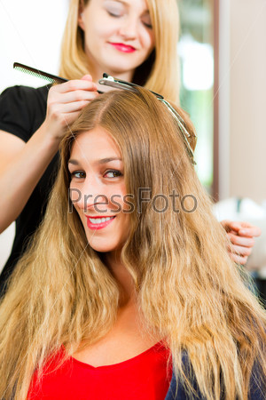 At the hairdresser - woman gets new hair colour