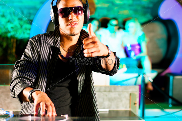 DJ in disco club, crowd background