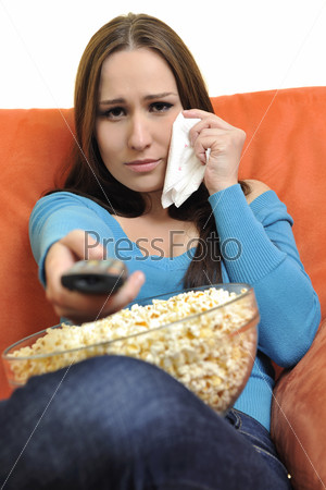 young woman eat popcorn and watching tv
