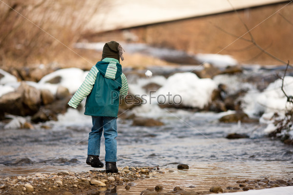 Boy with snow on river