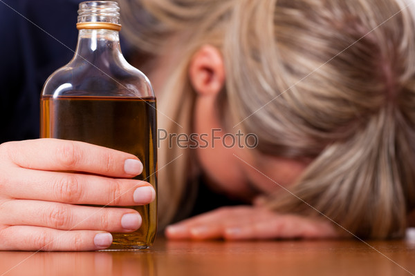 Alcohol abuse - woman drinking too much brandy