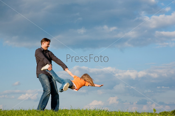 Father and child playing together