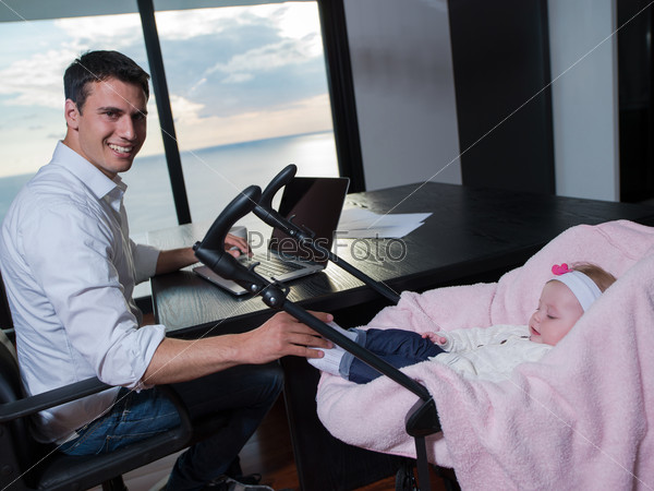 man working from home and take care of baby